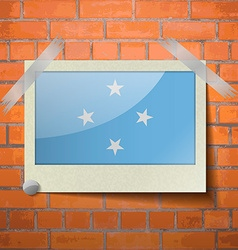 Flags micronesia scotch taped to a red brick wall vector