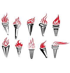 Set of burning torches with fire flames vector