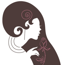 Beautiful woman silhouette with a flower vector