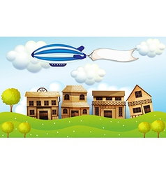 An airship above the neighborhood with a banner vector