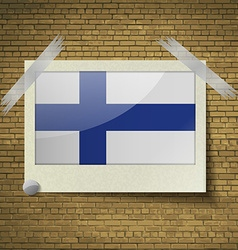 Flags finland at frame on a brick background vector