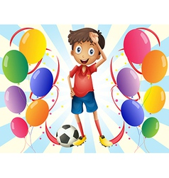 A soccer player in the middle of the balloons vector