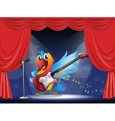 A parrot with a guitar at the stage vector