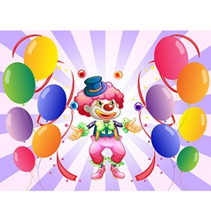 A clown juggling in the middle of the balloons vector