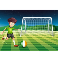A soccer player kicking the ball with the flag of vector