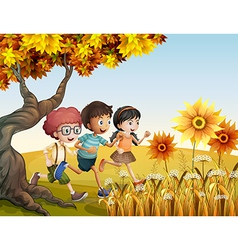 Children running at the hill with sunflowers vector
