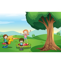 Kids playing above the hills vector