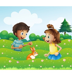 A girl and a boy with a bunny at the hill vector