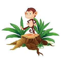 A monkey above a trunk vector