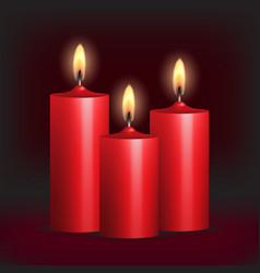 Three red burning candles on black background vector