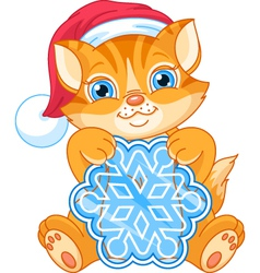 Kitten and snowflake vector