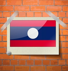 Flags laos scotch taped to a red brick wall vector