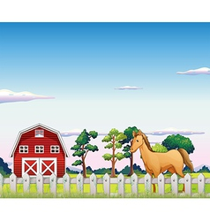 A horse inside the fence with a barn vector