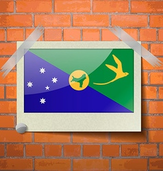 Flags christmas island scotch taped to a red brick vector