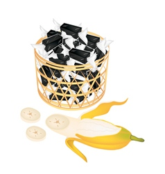 A brown basket of sweet banana candies vector