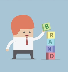 Businessman is building brand word brand building vector