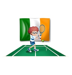 A boy playing tennis in front of the ireland flag vector