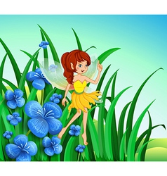 A fairy guarding the flowers vector