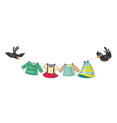 Hanging clothes with two black birds vector