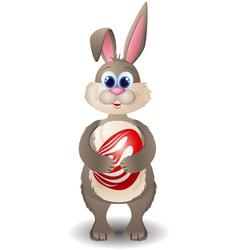 Cartoon rabbit with red egg vector