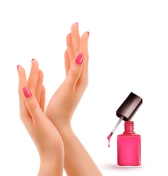 Female beautiful hands with a pink nail polish vector