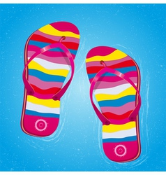 Beach slippers in water vector