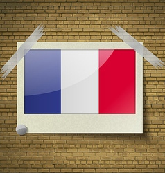 Flags frence at frame on a brick background vector