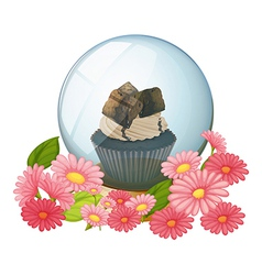 A crystal ball with a chocolate flavored cupcake vector