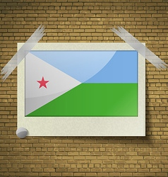 Flags djibouti at frame on a brick background vector