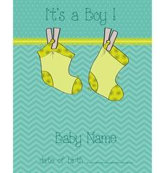 Baby boy arrival card with socks vector