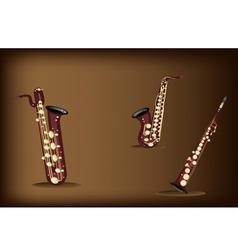 Three retro saxophone on dark brown background vector