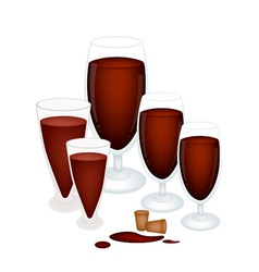Grape juice in glass with wine cork vector