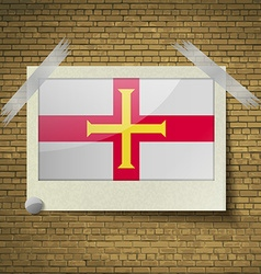 Flags guernsey at frame on a brick background vector