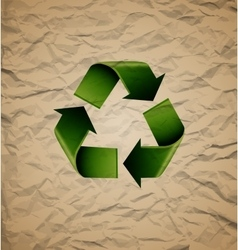 Green recycle symbol on crumpled cardboard vector