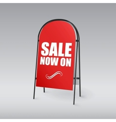 Pavement sign with the text sale now on vector
