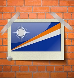 Flags marshll islands scotch taped to a red brick vector