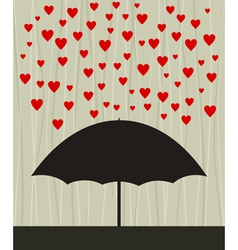 Umbrella with raining hearts vector