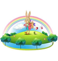 A bunny with a basket of eggs vector