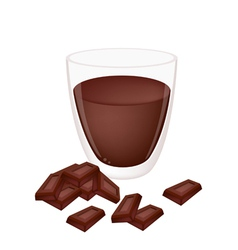 A cup of hot cocoa with chocolate vector
