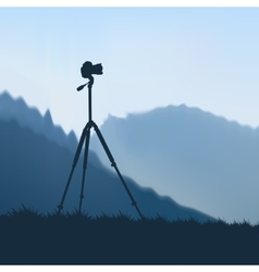 Camera on a tripod vector