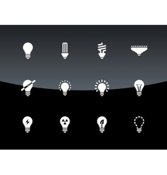 Light bulb and cfl lamp icons on black background vector