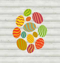 Easter ornamental eggs on wooden background vector