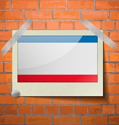 Flags crimea scotch taped to a red brick wall vector