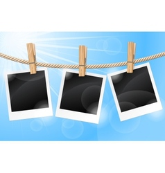 Photos hanging on a clothesline vector