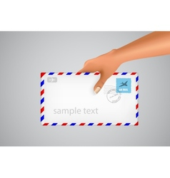 Hand holds the envelope vector