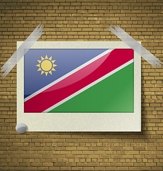 Flags namibiaat frame on a brick background vector