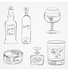 Set of glasses and whiskey bottles vector