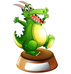 A smiling green dragon above the empty label vector