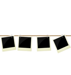 Four polaroid photos hanging on rope vector