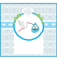 Baby boy card - a stork delivering a cute baby boy vector